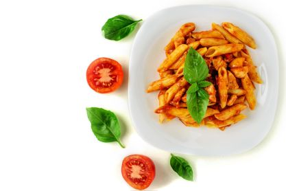 86570923 - penne pasta with bolognese sauce, tomato and basil on plate isolated